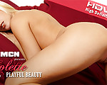 Playful Beauty - Colette just woke up and starts lolling around her bed